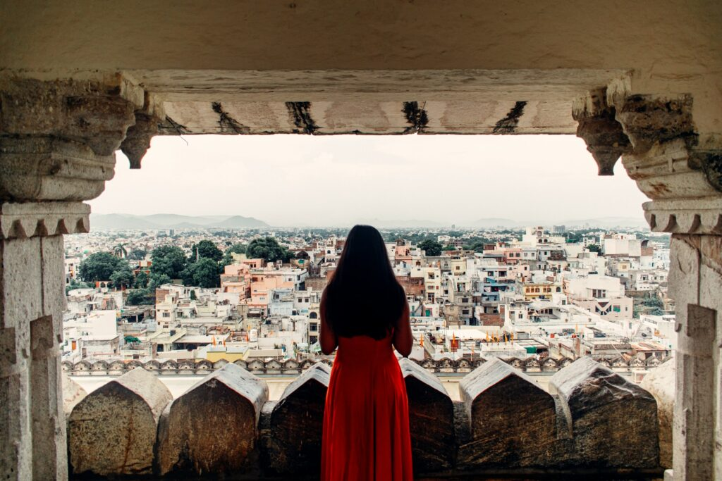 old city & a girl in red dress