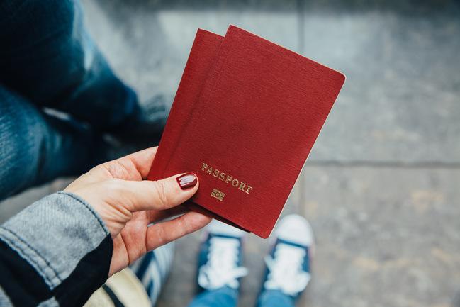 Woman holding passports